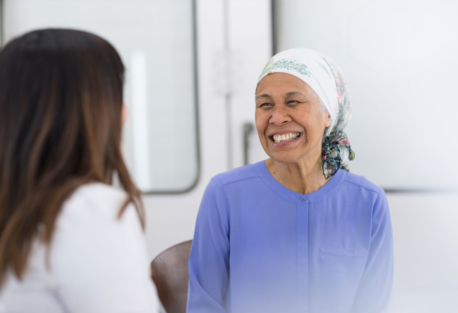 Female patient smiling at her doctor