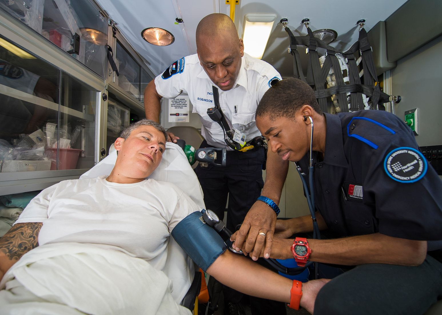 image of a two paramedics in an ambulance with a patient