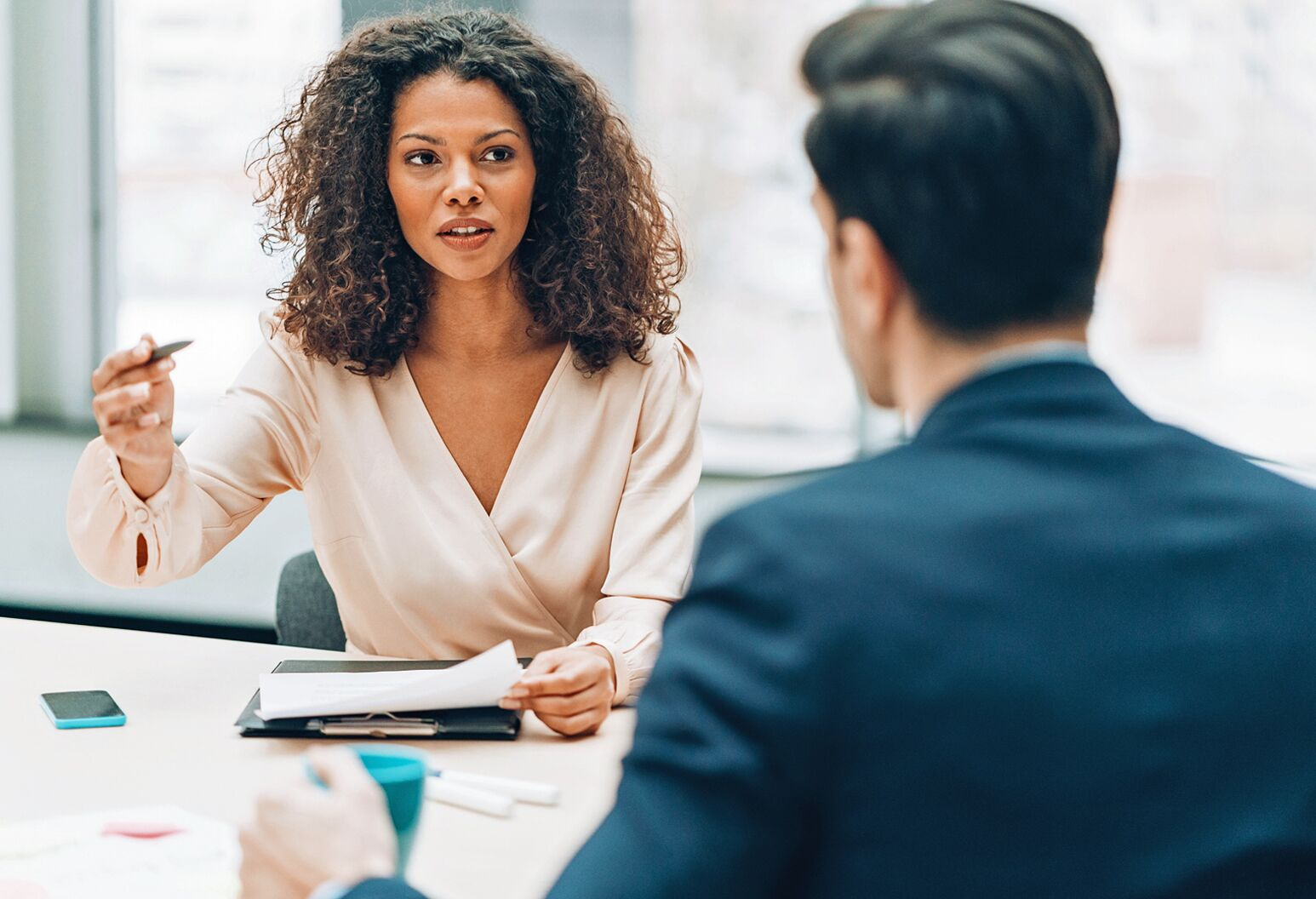 A black woman meets with a man in a blue suit. Northwell President and CEO Michael Dowling offers six tips for leaders to stay relentlessly and unapologetically focused.