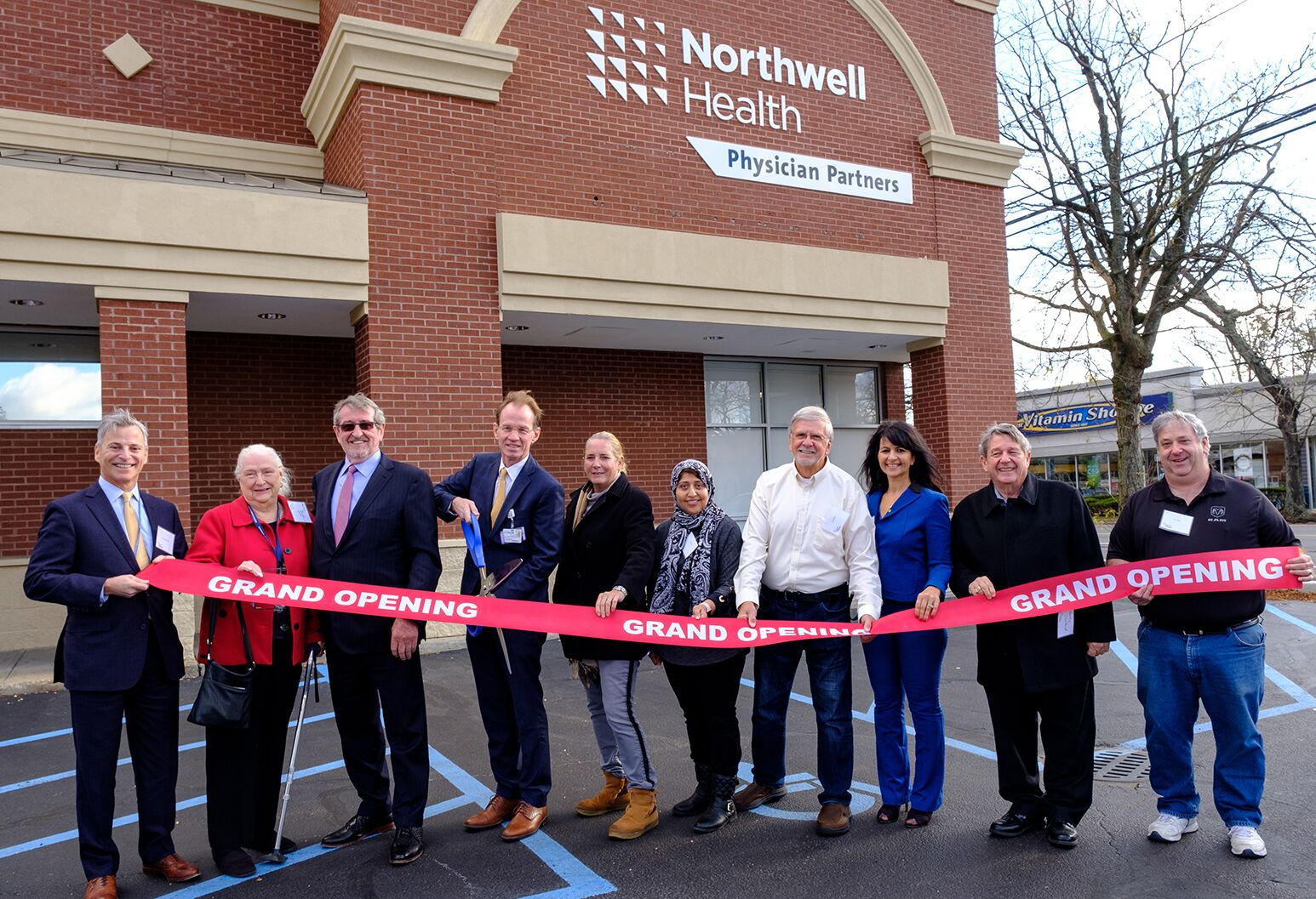 Northwell Health President and CEO Michael Dowling (third from left), along with Northwell and local dignitaries, cut the ribbon on of Northwell Health Physician Partners' Merrick facility.