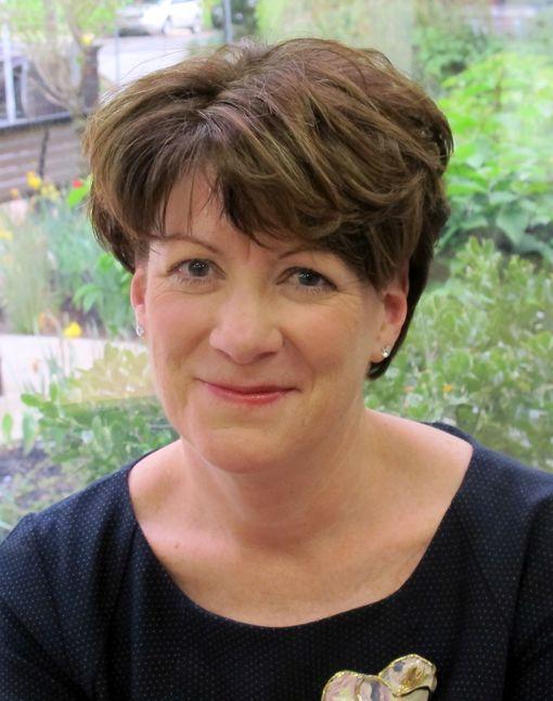 Mary McDermott, RN, wearing a black shirt