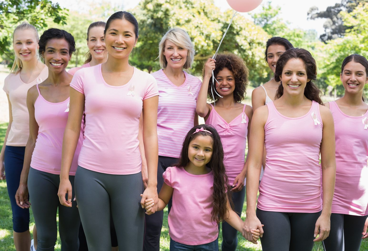 Women of all ages with pink shirts to support breast cancer awareness month.
