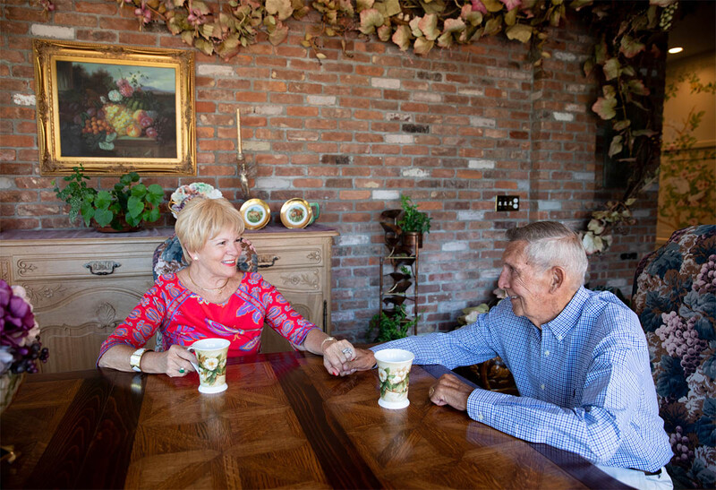 Rick and Susan Imbert holding hands at home